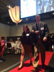 Yvette heads to the stage escorted by nominator Brian Reh